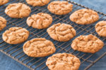 Flour-less peanut butter cookies cooling on a rack